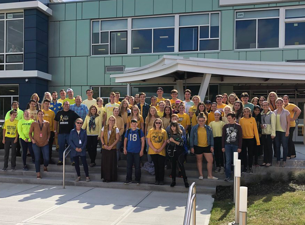 Staff and students wear yellow