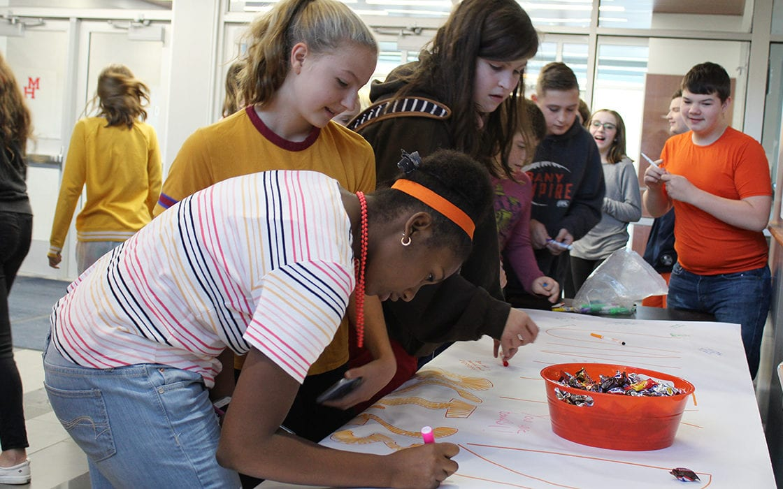 Students sign Unity Day banner