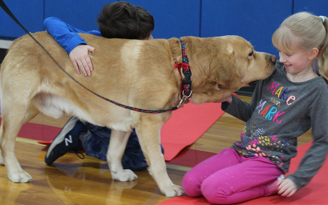 Students with therapy dog