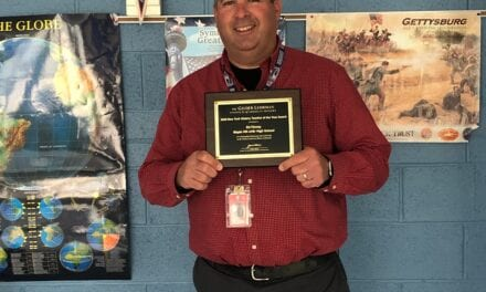 Mr. Finney Presented With Plaque for Teacher of the Year Award